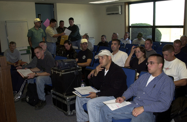 Members of the 128th Air Refueling Wing (ARW) Security Forces Squadron (SFS), Wisconsin Air National Guard, receive a deployment briefing before shipping out in support of Operation ENDURING FREEDOM