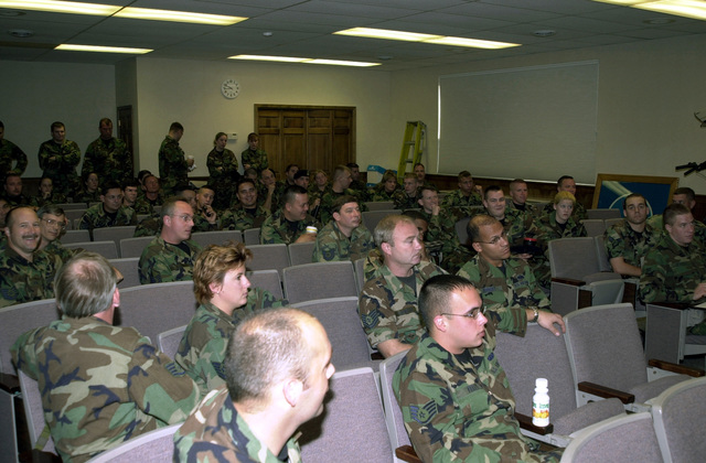 Members of the 128th Air Refueling Wing (ARW), Wisconsin Air National Guard, receive their final out briefing before deploying in support of Operation ENDURING FREEDOM