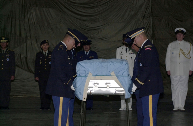 Members of the United Nations Honor Guard carry the remains of soldiers found in Korea. The remains were found in North Korea around the city of Pyongyang, within Unsan and Kujang provinces, near the Chong Chon River and around the Chosin Reservoir. In all, 17 bodies were discovered. The United Nations held a Repatriation Ceremony upon their return to NATO soil. The ceremony consists of a 21-gun salute, a prayer, a bagpipe tribute, and a wreath tribute from the local VFW Post