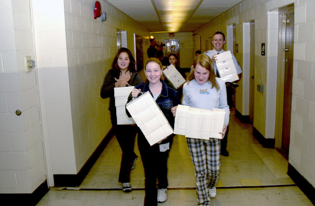 STAFF Sergeant Michael Antinucci helps Wallkill Middle School Seventh graders carry food boxes they put together and donated to the 105th Air National Guard members serving at Ground Zero at the World Trade Center collapse. The collapse due to terrorist flying two large passenger aircraft into the buildings; killing all in the planes and thousands in the building. Guard participation is part of Operation NOBLE EAGLE. NOBLE EAGLE is a partial mobilization of the reserves for homeland defense and civil support missions in response to the terrorist attacks on September 11, 2001 at the New York World Trade Center and the Pentagon