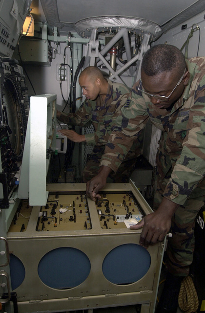 STAFF Sergeant (SSGT) Andre Newsome, (rear), USAF, and SSGT Nigel Ellis, USAF, Ramstein Air Base, Germany, perform Preventive Maintenance Inspections (PMI) on a transportable Airport Surveillance Radar. They perform PMIs on a regular basis, to ensure the readiness capabilities of their equipment