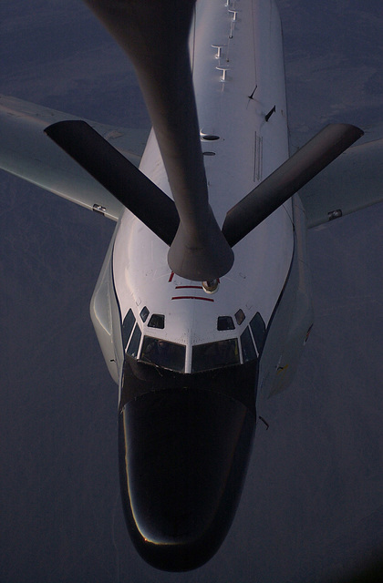 """An RC-135 Rivet Joint surveillance aircraft moves into position near the boom to receive """"gas"""" from a KC-135R Stratotanker from the 319th Air Expeditionary Group (AEG) Grand Forks, North Dakota. The 319th AEG deployed to a classified location in support of Operation ENDURING FREEDOM. Operation ENDURING FREEDOM is in support of the Global War on Terrorism (GWOT), fighting terrorism abroad"""