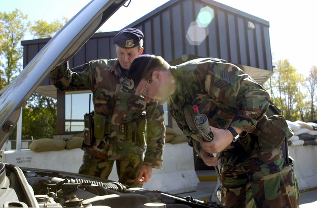 As part of the intensified security during Operation ENDURING FREEDOM, two members of the 128th Air Refueling Wing (ARW), Wisconsin Air National Guard (WANG), Security Forces Squadron, perform vehicle inspections at the front gate of the 128th ARW