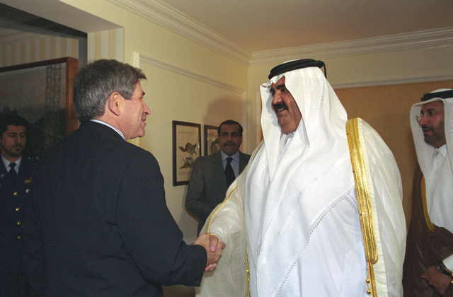 The Honorable Paul Wolfowitz (left), U.S. Deputy Secretary of Defense, greets the Amir of Qatar, Hamad bin Khalifa Al-Thani (right), at the Four Seasons Hotel, Washington, D.C., on Oct. 5, 2001.  OSD Package No. A07D-00714 (DoD photo by Ms. Helene C. Stikkel) (Released)