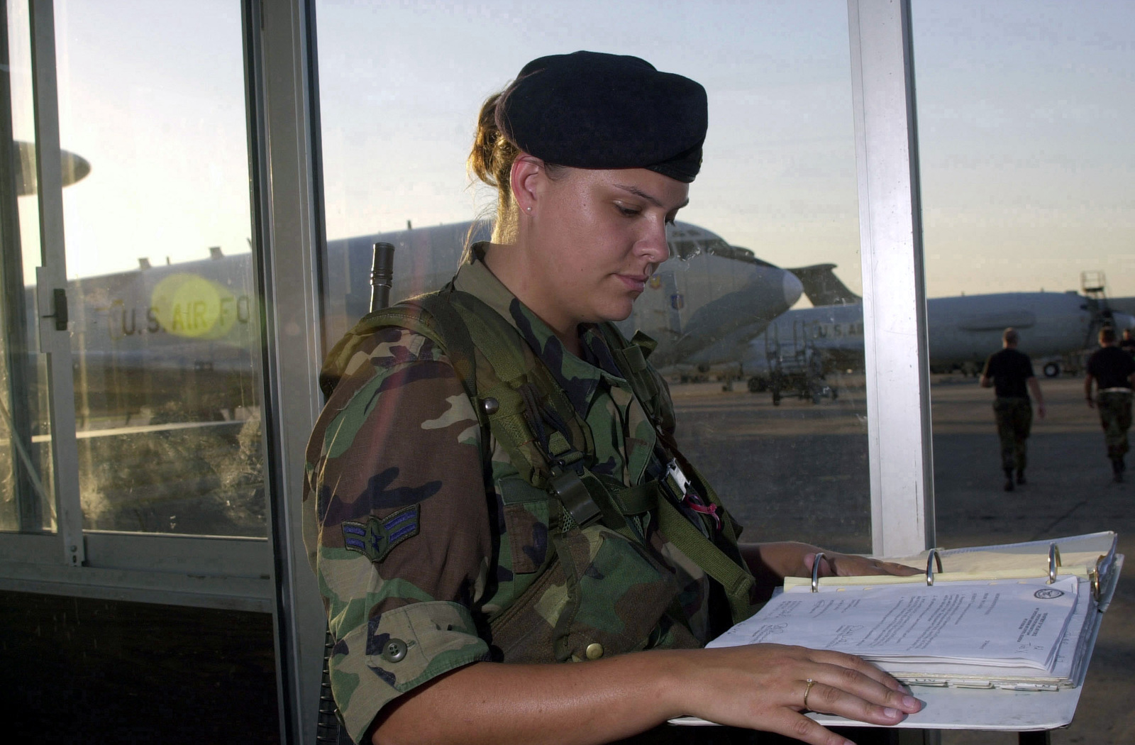 US Air Force (USAF) AIRMAN First Class (A1C) Shelly Byers, 325th Security Forces Squadron (SFS), reviews an entry authorization list at the entry control point to the flight line, while deployed at Incirlik Air Base (AB), Turkey, in support of Operation NORTHERN WATCH