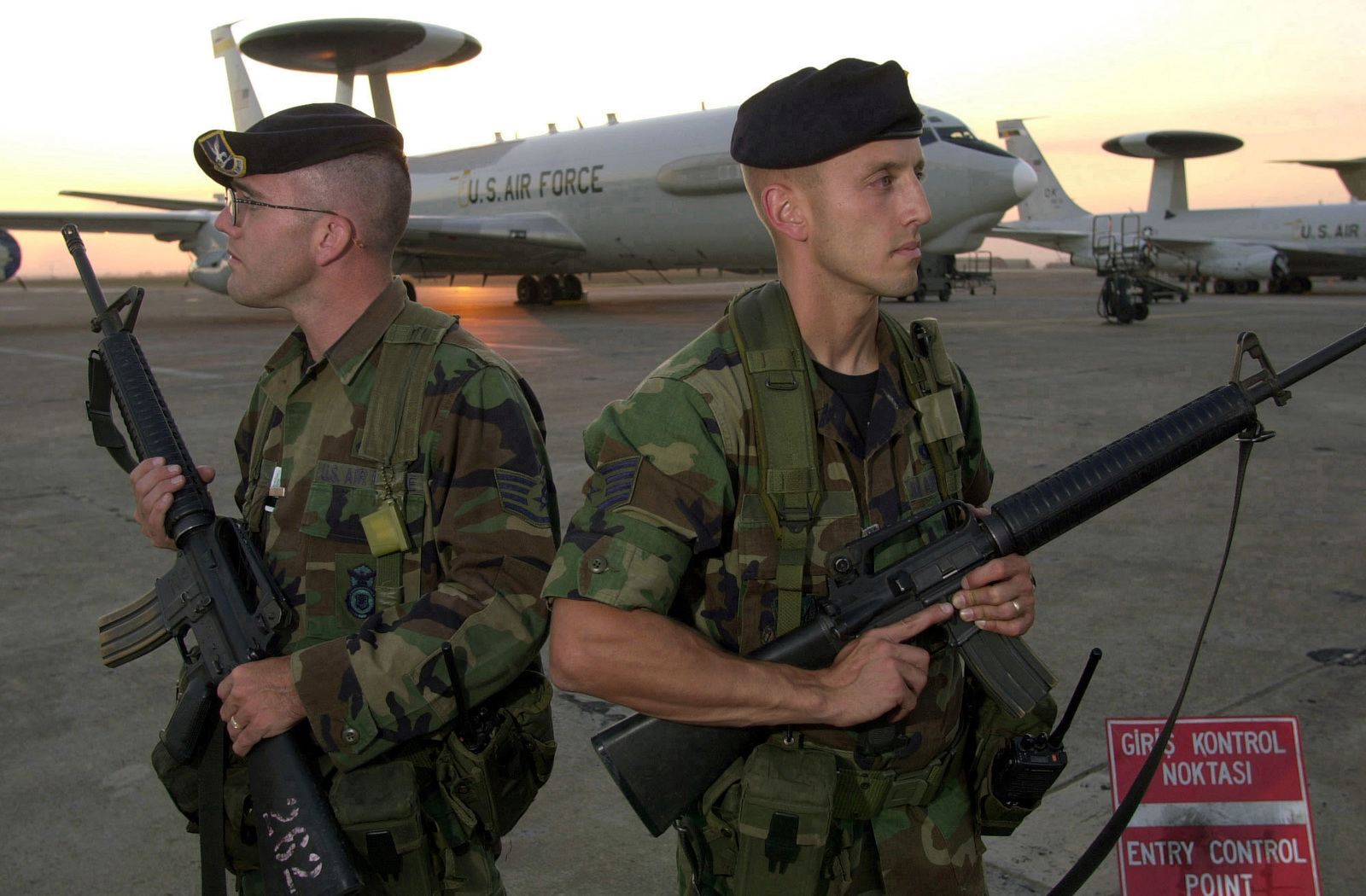 US Air Force (USAF) Security Police (SP) STAFF Sergeant (SSGT) Paul Evans (left), 172nd Fighter Wing (FW) and USAF SSGT John Duly, 175th FW, both armed with 5.56mm M16A2 rifles, guard USAF E-3C Sentry Airborne Early Warning and Control System (AWACS) aircraft on the flight line at Incirlik Air Base (AB), Turkey, while deployed in support of Operation NORTHERN WATCH