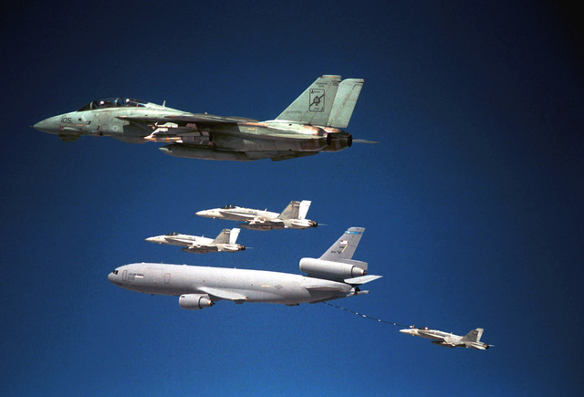 US Navy (USN) F-14D Tomcat aircraft assigned to Fighter Squadron Four One (VF-41) conduct air-to-air refueling operations with a US Air Force (USAF) KC-10 Extender aircraft from the 763rd Expeditionary Air Refueling Squadron (EARS), during a refueling mission flown in support of Operation ENDURING FREEDOM