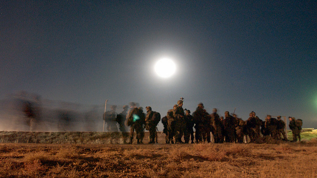 In the middle of the night, soldiers from the 10th Mountain Division, Fort Drum, New York, process through Asian customs at an undisclosed location during Operation ENDURING FREEDOM