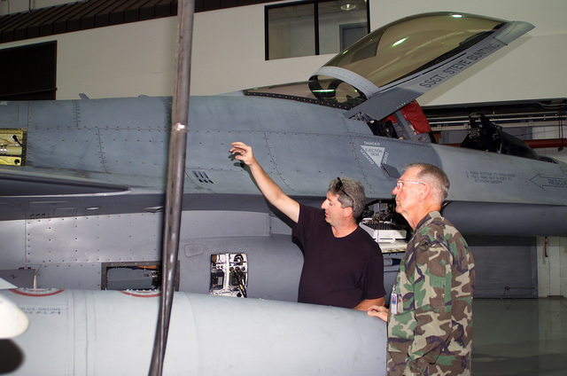 Flightline Avionics Technician Technical Sergeant Darrell W. Brown, (left), USAF, briefs Major General Donald C. Morrow, USA, The Adjutant General of Arkansas on the avionics packages in the F-16C Fighting Falcon. The General is visiting the 188th Fighter Wing, Arkansas Air National Guard at Fort Smith, Arkansas, during Operation NOBLE EAGLE