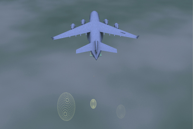 A top view of a 3D-video animation illustrating a C-17A Globemaster III on a humanitarian airdrop. The containers are placed onboard the C-17A and airdropped on October 7th over eastern Afghanistan as part of Operation ENDURING FREEDOM. Relief packets are shown as they move away and disperse from the aircraft. This animation simulation was created with Lightwave software to brief Air Force and DoD commanders and released to the media to demonstrate how the operation works. Video animation photo by SENIOR AIRMAN (SRA) Erich Fink
