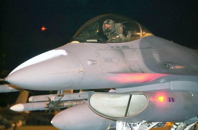An F-16C Fighting Falcon pilot from the 192nd Fighter Wing, Virginia Air National Guard, prepares for a nighttime mission from Byrd Field, Richmond International Airport (IAP), Virginia, in support of Operation NOBLE EAGLE