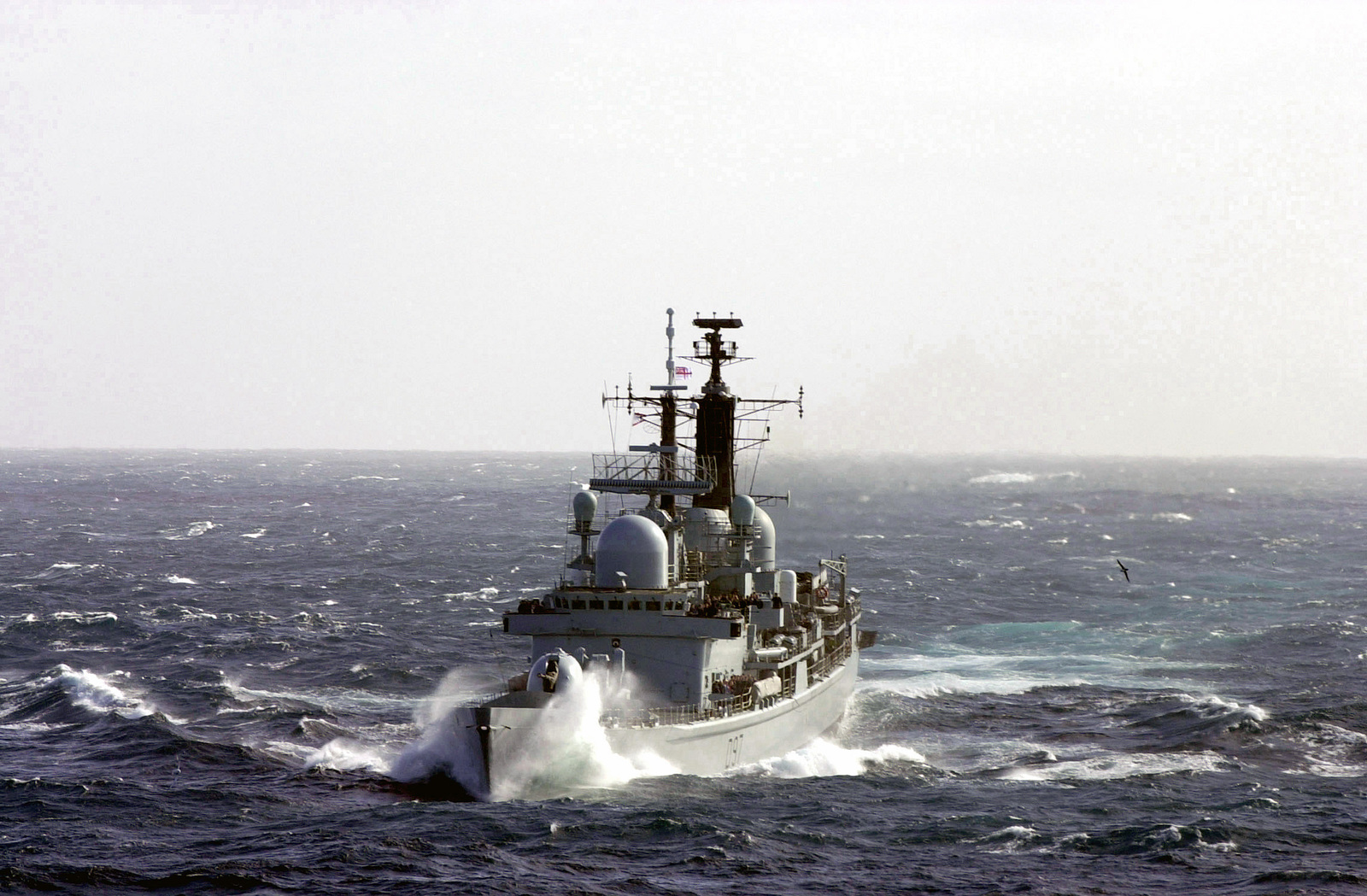 The bow port view of the Royal Navy Type 42 Class (DDG) Destroyer Her Majestys Ship (HMS) EDINBURGH (D 97) underway