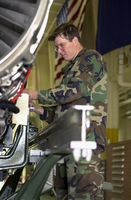 In support of Operation Noble Eagle, STAFF Sergeant Jonathon Cooper, an aircraft engine mechanic with the Virginia Air National Guard's 192nd Fighter Wing, works on the combustion chamber of the General Electric F110-GE-100 jet engine from an F-16C. The 192 FW is located just outside of Richmond in Sandston, Virginia. NOBLE EAGLE is a partial mobilization of the reserves for homeland defense and civil support missions in response to the terrorist attacks on September 11, 2001 at the New York World Trade Center and the Pentagon
