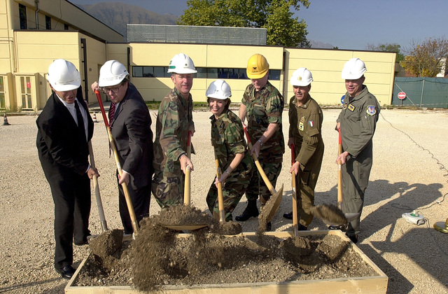 (L to R) Contractors Mr. Otto Weixler of Philip Holtzmann, Mr. Giacomo Adorno of GEBCO, Commander Dave Kelly, Navy, Resident Officer in Charge of Construction (ROICC), Colonel Jane E. Serie, Commander, 31st Medical Group, Aviano, Colonel Gary LaGassey, Aviano 2000 Program Manager and Brigadier General Donald J. Hoffman, Commander, 31st Fighter Wing, Aviano Air Base, Italy, break ground for a new hospital facility. This new 20-bed hospital will provide an ultra modern medical facility for Aviano Air Base. The project provides for a new 25,900 square foot hospital and for the alteration of 2780 square feet of the existing 31st Medical Group clinic. The new addition will include new...