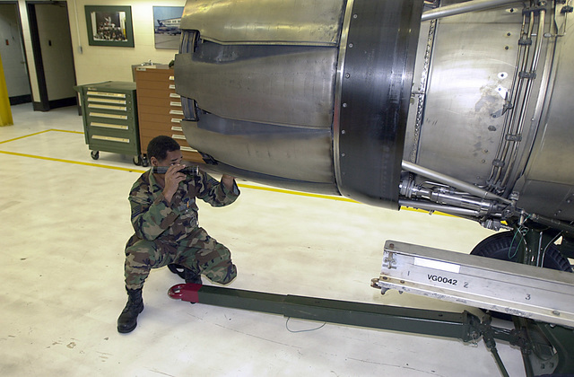 Working in support of Operation Noble Eagle, MASTER Sergeant Larry Anderson, an aircraft engine mechanic for the 192nd Fighter Wing (FW), performs an inspection of the variable nozzle on the afterburner of a General Electric F110-GE-100 jet engine for an F-16C Fighting Falcon. The 192 FW is located just outside of Richmond in Sandston, Virginia. NOBLE EAGLE is a partial mobilization of the reserves for homeland defense and civil support missions in response to the terrorist attacks on September 11, 2001 at the New York World Trade Center and the Pentagon