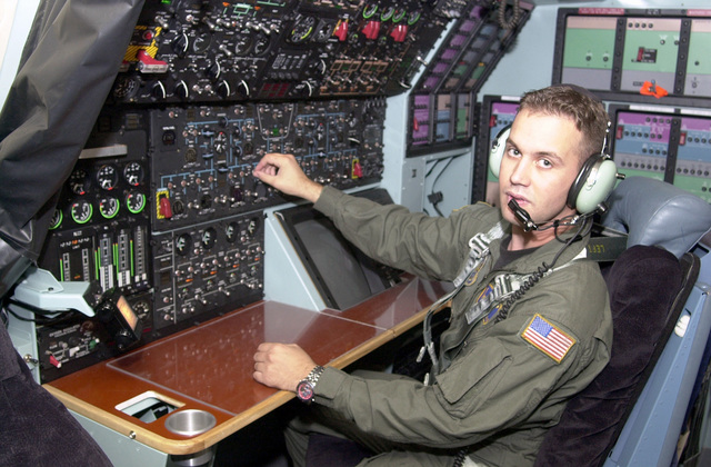 An illustration shot of 137th Airlift Squadron Flight Engineer SENIOR AIRMAN Joe Masztalics practices his craft in the 105th Airlift Wing's new C-5A simulator at Stewart Field, Newburgh, New York. PHOTO will be used in Wing publication to spotlight AFSC's (Air Force Specialty Code)