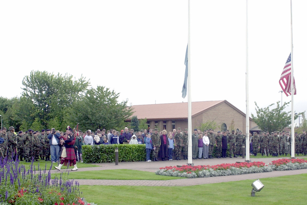 """After a three-minute period of silence was observed throughout the United Kingdom including RAF Lakenheath, Norman Taflinger, 3rd Air Force, Royal Air Force Mildenhall, plays """"Amazing Grace"""" on the bagpipes as he departs Liberty Circle. The three-minutes of silence is in respect and honor to those who perished during the terrorist attacks on the World Trade Centers Twin Towers and the Pentagon"""