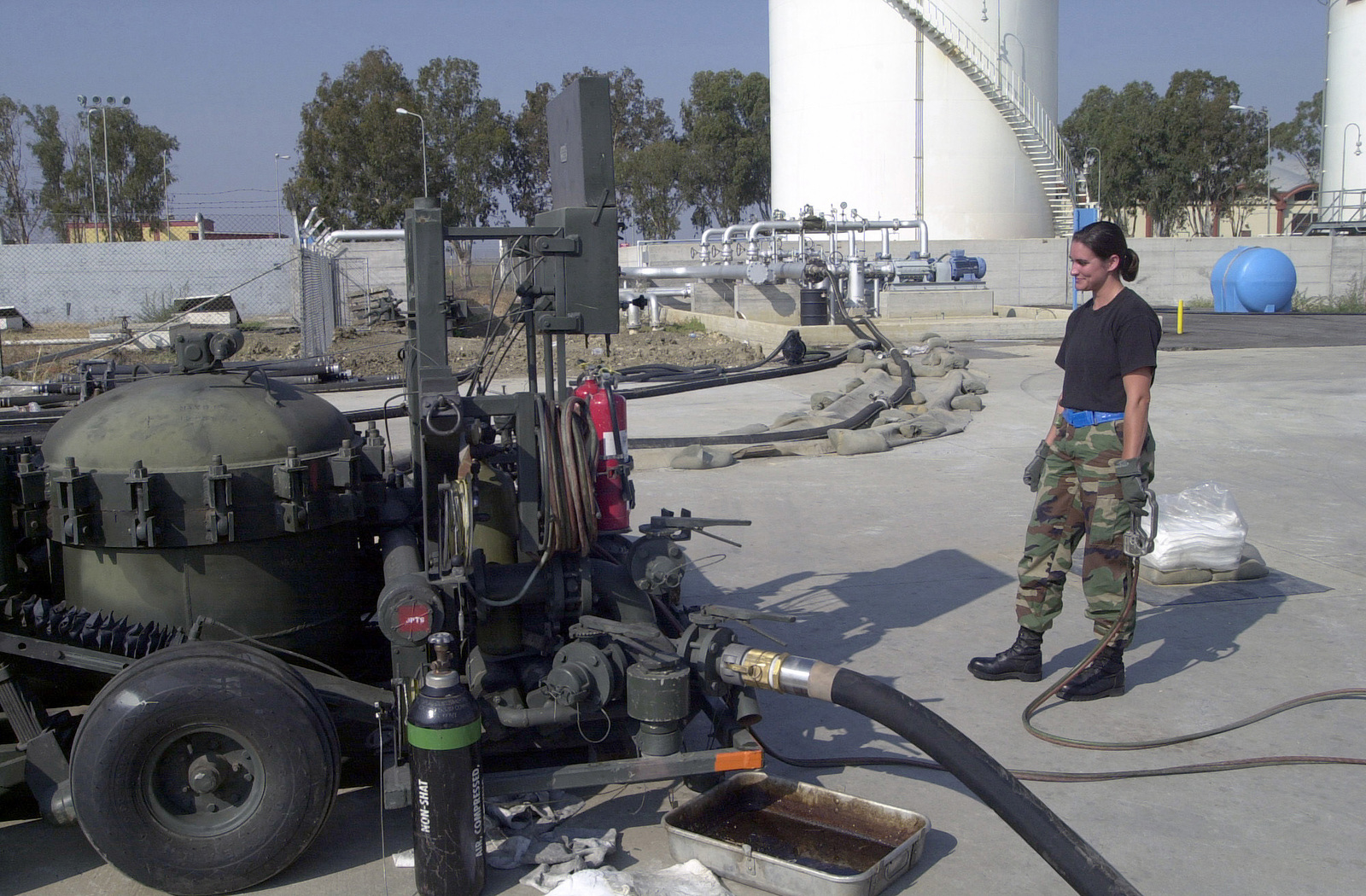 STAFF Sergeant Julia Nelson, US Air Force (USAF), fuels specialist, 375th Logistics Support Squadron, Scott Air Force Base, Illinois, monitors the gauges telling her how much fuel is being pumped into her fuel truck at Naval Air Station (NAS) Sigonella, Italy, during Operation ENDURING FREEDOM. In response to the terrorist attacks on September 11, 2001 at the New York World Trade Center and the Pentagon, President George W. Bush initiated Operation ENDURING FREEDOM in support of the Global War on Terrorism (GWOT), fighting terrorism abroad
