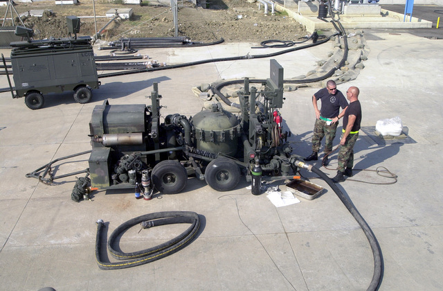 Technical Sergeant (TSGT) Richard Laux, (left), US Air Force (USAF), Non-Commissioned Officer in Charge of deployed Fuel Cell, 375th Logistics Support Squadron, Scott Air Force Base, Illinois, and TSGT T. J. Theis, 96th Supply Squadron, Eglin AFB, Florida, monitor a pump station at Naval Air Station (NAS) Sigonella, Italy, during Operation ENDURING FREEDOM. In response to the terrorist attacks on September 11, 2001 at the New York World Trade Center and the Pentagon, President George W. Bush initiated Operation ENDURING FREEDOM in support of the Global War on Terrorism (GWOT), fighting terrorism abroad