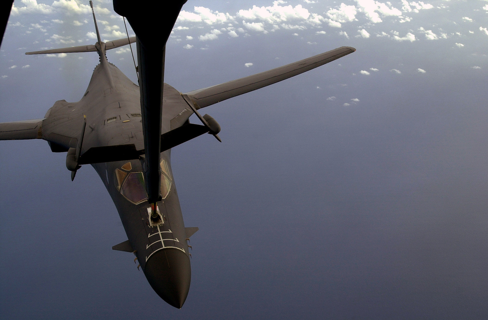 A B1-B Lancer bomber connects with and receives fuel from a KC-10 Extender over the Indian Ocean prior to a bombing sortie into Afghanistan for Operation Enduring Freedom. Both aircraft are from the 28th Air Expeditionary Wing. In response to the terrorist attacks on September 11, 2001 at the New York World Trade Center and the Pentagon, President George W. Bush initiated Operation ENDURING FREEDOM in support of the Global War on Terrorism (GWOT), fighting terrorism abroad