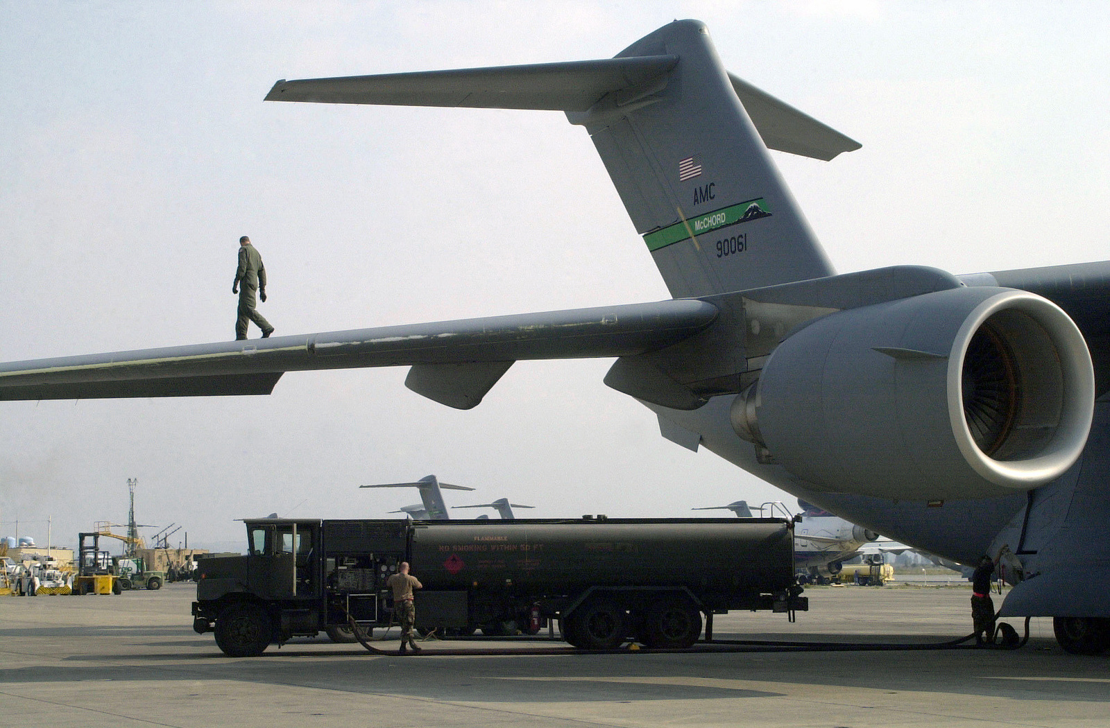 An R-11 fuel truck refuels C-17A Globemaster III on the ramp at Naval Air Station (NAS) Sigonella, Italy, during Operation ENDURING FREEDOM. In response to the terrorist attacks on September 11, 2001 at the New York World Trade Center and the Pentagon, President George W. Bush initiated Operation ENDURING FREEDOM in support of the Global War on Terrorism (GWOT), fighting terrorism abroad