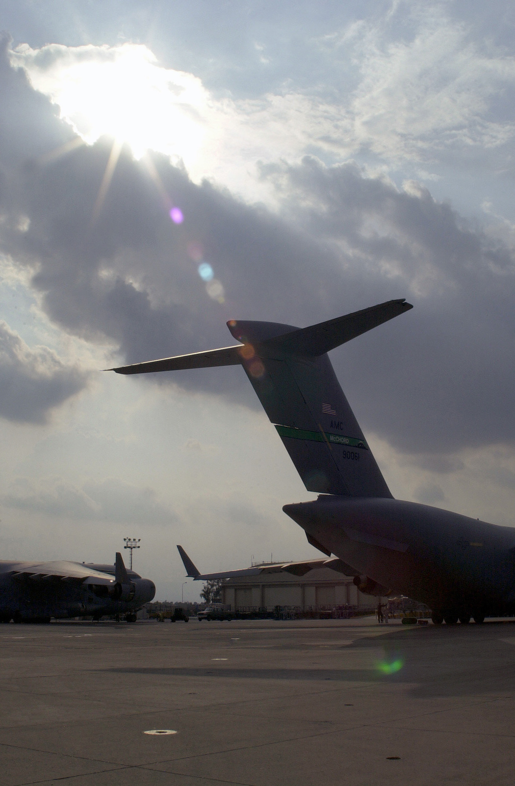 C-17A Globemaster IIIs, wait on the ramp to be loaded at Naval Air Station (NAS) Sigonella, Italy. The aircraft will carry troops and cargo to forward locations in support of OPERATION ENDURING FREEDOM. In response to the terrorist attacks on September 11, 2001 at the New York World Trade Center and the Pentagon, President George W. Bush initiated Operation ENDURING FREEDOM in support of the Global War on Terrorism (GWOT), fighting terrorism abroad