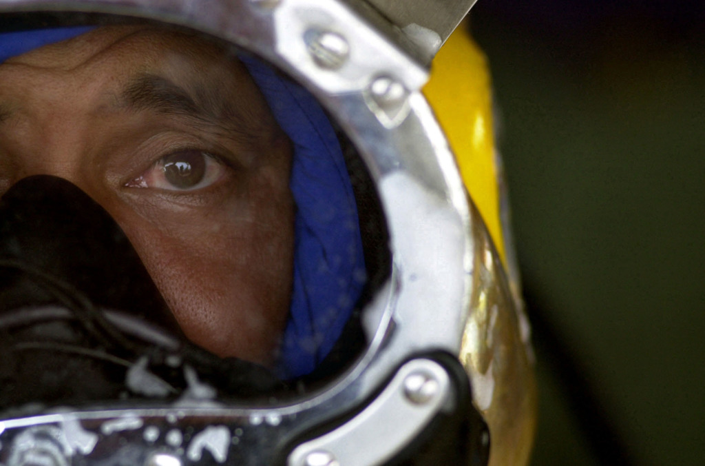 Close up view of a diver from the Japanese Maritime Self Defense Force wearing the MK-21 diving helmet, during the recovery of the sunken Japanese fishing vessel, Ehime Maru