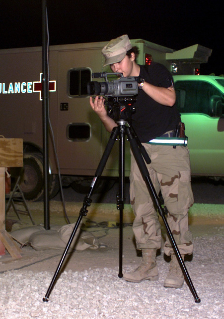 AIRMAN Michelle Gaudin, USAF, 509th Communications Squadron, prepares to capture nightlife on video at an undisclosed location while deployed in support of Operation ENDURING FREEDOM. In response to the terrorist attacks on September 11, 2001 at the New York World Trade Center and the Pentagon, President George W. Bush initiated Operation ENDURING FREEDOM in support of the Global War on Terrorism (GWOT), fighting terrorism abroad