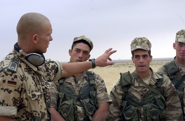 Officer Cadet, Jens Kempf from the German Army, explains to Greek soldiers how to shoot the MG3 machine gun during a small arms training course held at Mubarak Military City in Egypt during Exercise BRIGHT STAR 01/02. BRIGHT STAR 01/02 is a multinational exercise involving more than 74,000 troops from 44 countries that enhances regional stability and military-to-military cooperation among our key allies, and our regional partners. It prepares US Central Command to rapidly deploy and employ the forces needed to deter aggressors and, if necessary, fight and win side-by-side with our allies and regional partners
