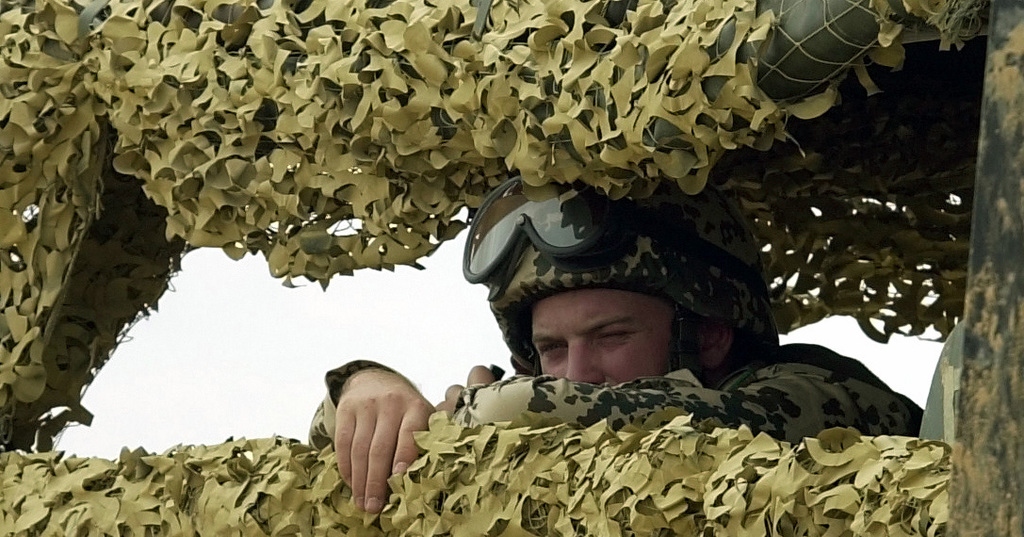 Private First Class (PFC), Eugen Braun, German Army, peers through the camouflaged netting on back of a German Army truck during a small arms training course held at Mubarak Military City in Egypt during Exercise BRIGHT STAR 01/02. BRIGHT STAR 01/02 is a multinational exercise involving more than 74,000 troops from 44 countries that enhances regional stability and military-to-military cooperation among our key allies, and our regional partners. It prepares US Central Command to rapidly deploy and employ the forces needed to deter aggressors and, if necessary, fight and win side-by-side with our allies and regional partners