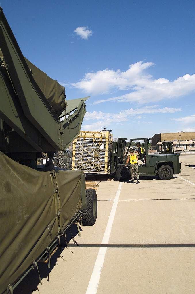 Members of Davis-Monthan AFB, Arizona, using Hyster 10K forklift prepare support cargo for deployment in support of Operation ENDURING FREEDOM. In response to the terrorist attacks on September 11, 2001 at the New York World Trade Center and the Pentagon, President George W. Bush initiated Operation ENDURING FREEDOM in support of the Global War on Terrorism (GWOT), fighting terrorism abroad