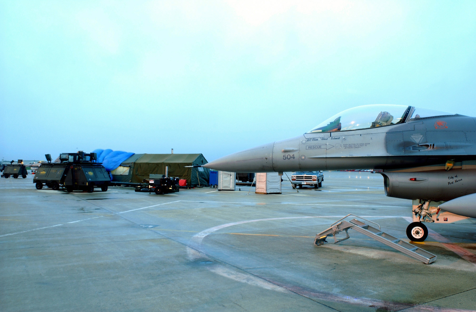 A 127th Wing, Michigan Air National Guard (ANG) F-16C Fighting Falcon aircraft is parked near the temporary alert tent, on the flight line at Selfridge Air National Guard Base (ANGB), in support of Operation NOBLE EAGLE