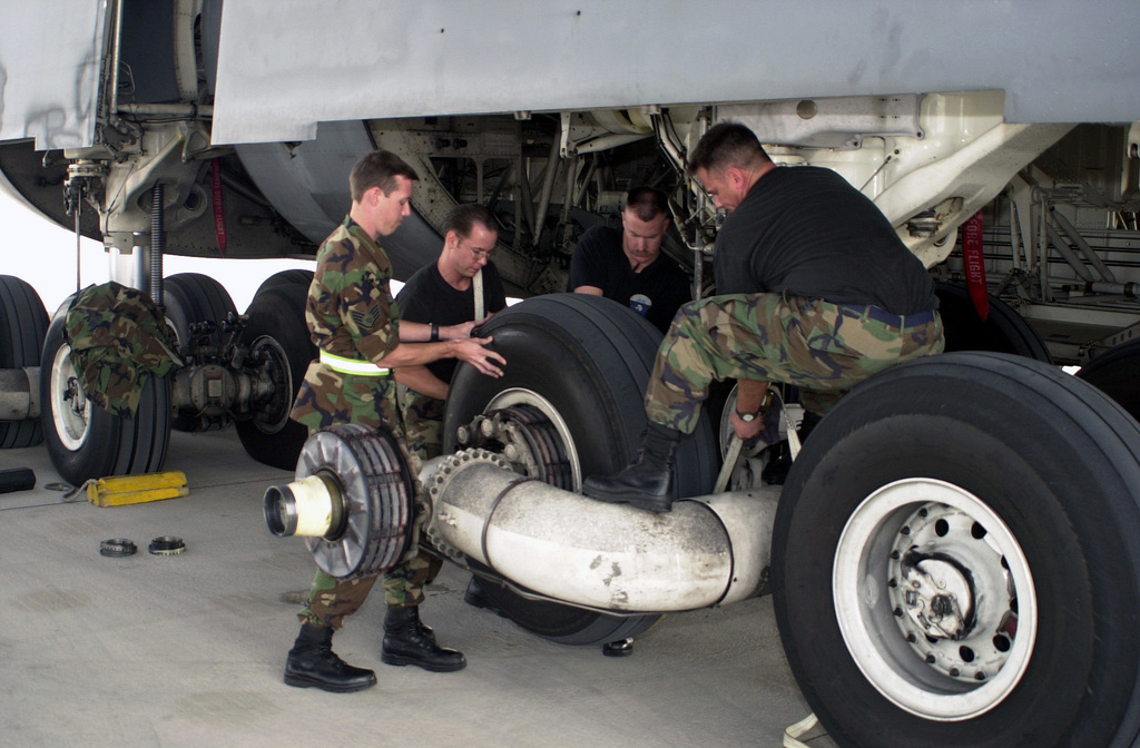 (Left to Right) US Air Force (USAF) STAFF Sergeant (SSGT) Bruce Weidemann, SENIOR AIRMAN Brian Justus, SSGT Mike Casey, 436th Aircraft Generation Squadron (AGS), Dover AFB, Delaware, and Technical Sergeant Glenn Holly, 62nd AGS, McChord AFB, Washington, change out a tire on the main landing gear of a C-5A Galaxy at Naval Air Station Sigonella, Sicily, during Operation ENDURING FREEDOM. In response to the terrorist attacks on September 11, 2001 at the New York World Trade Center and the Pentagon, President George W. Bush initiated Operation ENDURING FREEDOM in support of the Global War on Terrorism (GWOT), fighting terrorism abroad