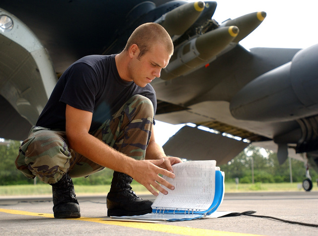 An Air Force B-52 Stratofortress crewchief from the 28th Air Expeditionary Wing looks over his aircraft checklist during Operation Enduring Freedom. The aircraft is loaded and readied for a combat mission over Afghanistan. Air Force B-2 Spirit, B-1 Lancer, and B-52 Stratofortress, bombers expended more than 80 percent of the tonnage dropped on combat missions over Afghanistan to date. The Air Force flew more than 600 sorties including strike missions against al Qaeda and Taliban targets in Afghanistan. These targets include early-warning radar systems, ground forces, Command-and-Control facilities, al Qaeda infrastructure, airfields and aircraft. Operation ENDURING FREEDOM is in support ...