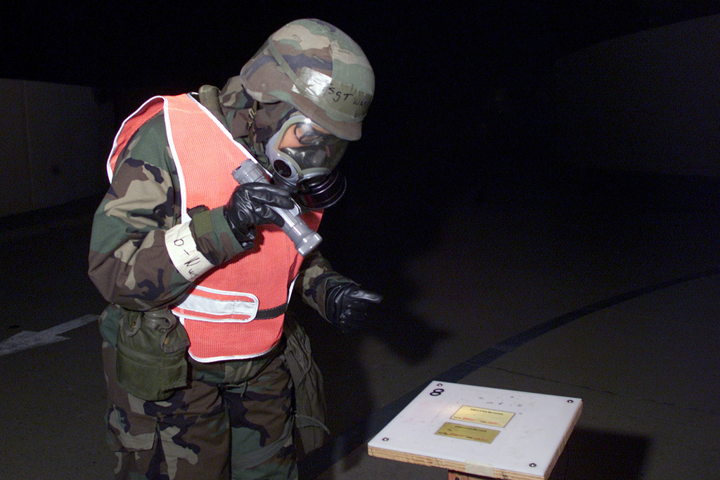 Technical Sergeant (TSGT), Sabrina Watkins, USAF, 51st Medical Squadron, Osan AB, Korea wears Mission Oriented Protective Posture response level 4 (MOPP-4) gear as she checks the M-8 paper around the hospital as part of the post attack procedures during the Initial Response Readiness Exercise/Combat Employment Readiness Exercise (IRRE/CERE) at Osan AB, Korea