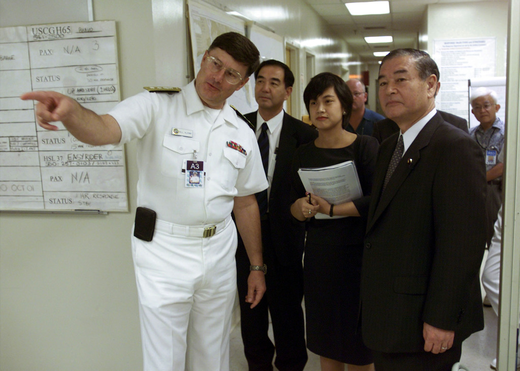 US Navy (USN) Rear Admiral (RADM) William R. Klemm (left), Project Coordinator for the Ehime Maru Recovery Operations, shows Toshio Kojima, Parliamentary Secretary of Japan, the inner workings or the Ehime Maru Command Center (EMCC) during the Secretary's official visit to Hawaii (HI)