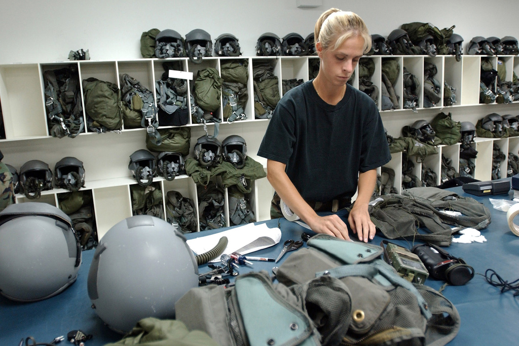 An Air Force Aircrew Life Support member from the 28th Air Expeditionary Wing, Diego Garcia, performs routine maintenance on a survival vest during Operation ENDURING FREEDOM. Aircrew Life Support members perform preventative maintenance every 30 days on aircrew helmets, masks, and survival vest to ensure pilots are always prepared for a mission. In response to the terrorist attacks on September 11, 2001 at the New York World Trade Center and the Pentagon, President George W. Bush initiated Operation ENDURING FREEDOM in support of the Global War on Terrorism (GWOT), fighting terrorism abroad
