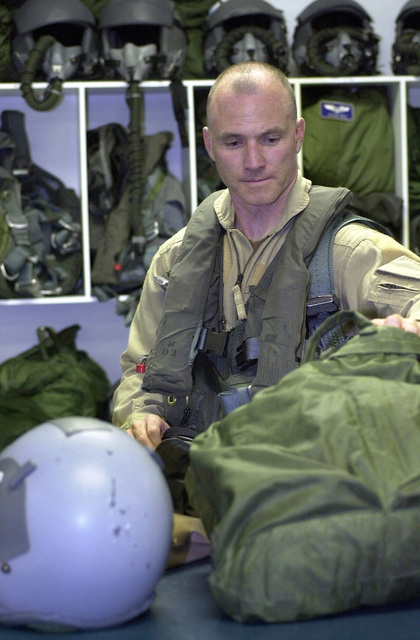 An Air Force pilot from the 28th Air Expeditionary Wing, Diego Garcia, empties his flight gear after returning from a combat mission over Afghanistan during Operation ENDURING FREEDOM. The gear will be checked right away by Aircrew Life Support members. Generally, Life Support performs preventative maintenance every 30 days on aircrew flight helmets, oxygen masks, and survival vest to ensure pilots are always prepared for a mission. Operation ENDURING FREEDOM is in support of the Global War on Terrorism (GWOT), fighting terrorism abroad, initiated in response to the terrorist attacks on September 11, 2001 at the New York World Trade Center and the Pentagon