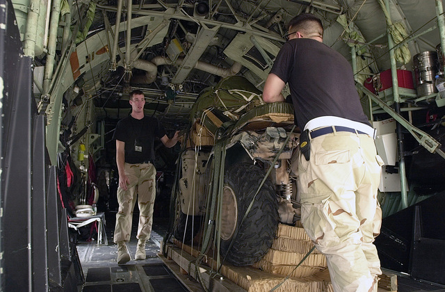 Maintenance troops prepare to download a Yamaha All Terrain Vehicle (ATV) on a pallet from the inside of an MC-130P Combat Shadow to make room for the jumpers. The aircraft and crew arrived at Al Udeid Air Base, Qatar, in support of Operation SOUTHERN WATCH as a Combat Search and Rescue unit