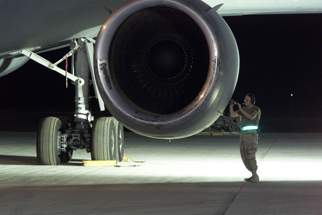 Technical Sergeant Loyd Bourner, USAF, 660th Aircraft Generation Squadron, Travis AFB, California, gets the status on the KC-10 Extenders General Electric CG6-50C2 turbofan engine from his crew in the cockpit. He is using the aircraft intercom system while performing an engine test on the aircraft at a deployed base in the Persian Gulf in support of Operation ENDURING FREEDOM. In response to the terrorist attacks on September 11, 2001 at the New York World Trade Center and the Pentagon, President George W. Bush initiated Operation ENDURING FREEDOM in support of the Global War on Terrorism (GWOT), fighting terrorism abroad