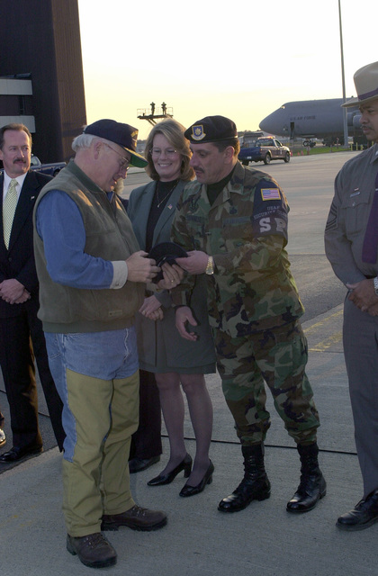 Major John Chianese, USAF, Commander, 105th Security Forces Squadron (SFS), gives Vice President Dick Cheney an NYPD Emergency Service Cap. He informed the Vice President that Unit lost a member; SENIOR AIRMAN (SRA) Jerome Dominguez, in the tragic events of September 11, and that he was an Emergency Services Unit (ESU) Officer. MAJ Chianese also gave him a card with SRA Jerome's picture on it. The members of the 105th SFS made up the card with Jerome's picture on the front (In his ESU uniform standing atop the Brooklyn Bridge) and a prayer on the back. Vice President Cheney is returning to Washington DC after attending a private event in Dutchess County New York