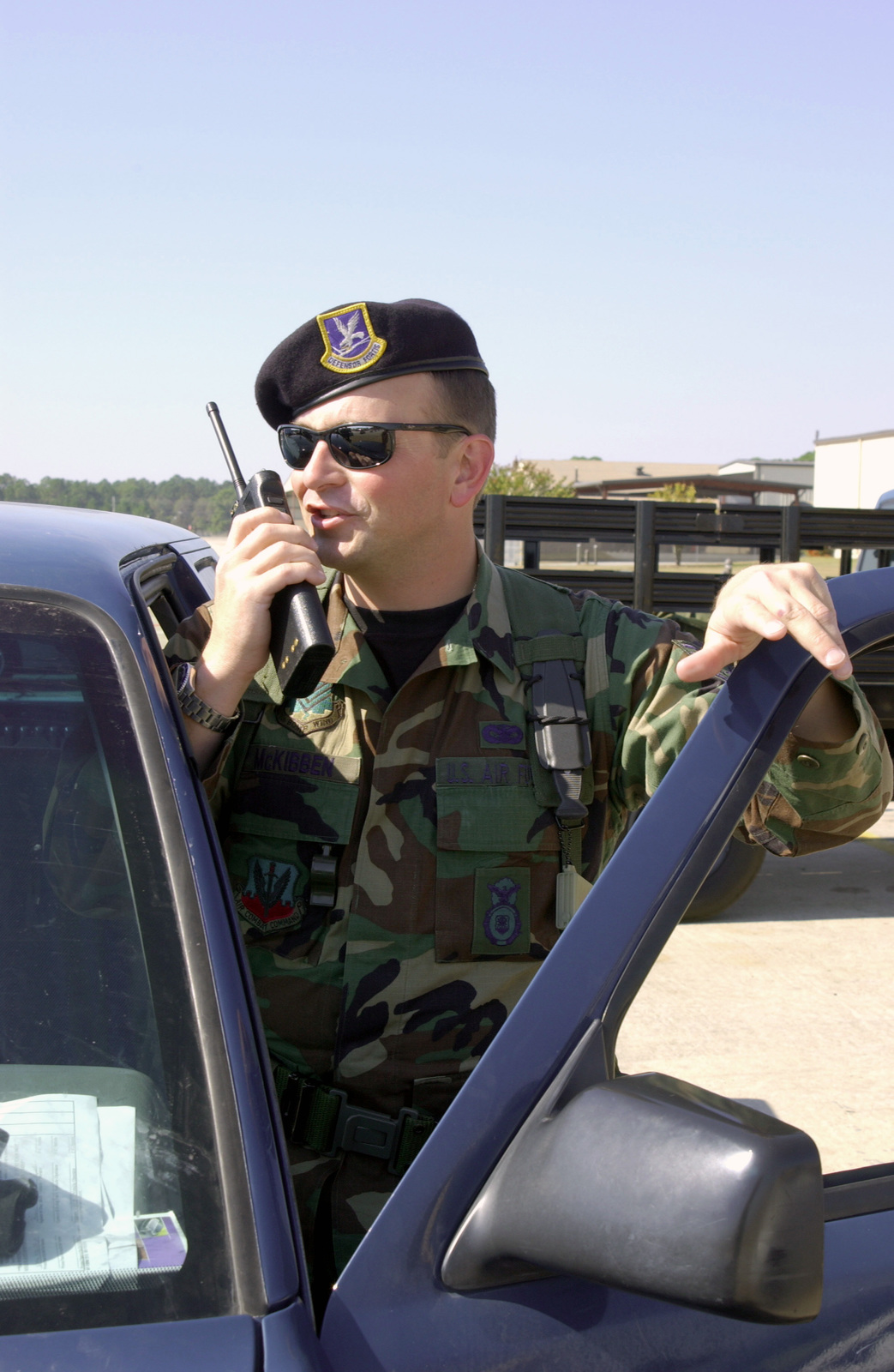 Using a hand held radio, STAFF Sergeant Ken McKibben, USAF, 116th Security Police Squadron, Robins Air Force Base, Georgia, reports any suspicious activity on the flight line at his temporary station at Moody Air Force Base, during Operation NOBLE EAGLE. NOBLE EAGLE is a partial mobilization of the reserves for homeland defense and civil support missions in response to the terrorist attacks on September 11, 2001 at the New York World Trade Center and the Pentagon