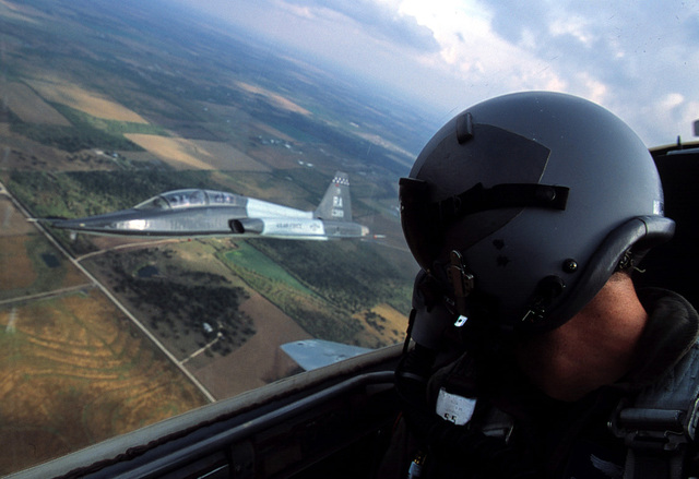 Air-to-air view showing the co-pilots position onboard an USAF T-38 Talon aircraft from 560th Flying Training Squadron, Randolph AFB, TX. The co-pilot flying is watching his wingman flying in formation