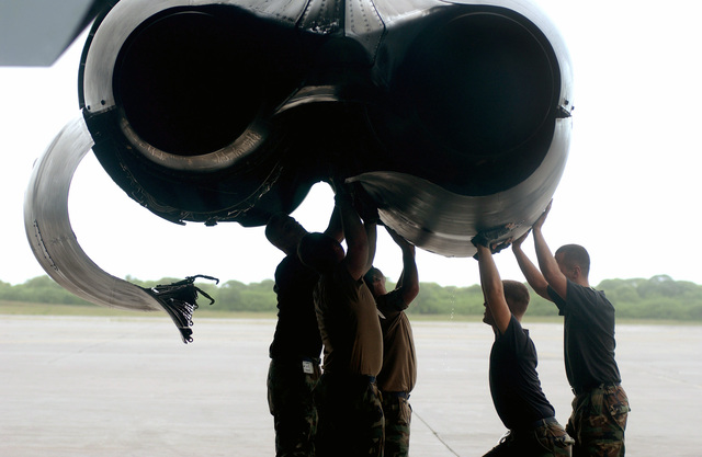 B-52 Crew Chiefs from the 28th Air Expeditionary Wing (EW) open the engine covers on a B-52 Stratofortress bomber, during Operation ENDURING FREEDOM