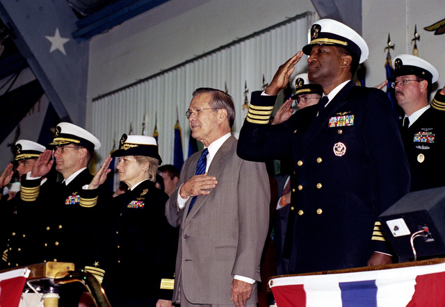 The Honorable Donald H. Rumsfeld, U.S. Secretary of Defense (2nd from right) and (left to right) U.S. Navy CHIEF of Naval Education and Training, Vice Adm. Alfred G. Harms Jr., Commander Naval Training Center Great Lakes Rear Adm. Ann E. Rondeau, and CAPT. Edward W. Gantt, salute during the playing of the National Anthem at the Naval Training Center Great Lakes, Great Lakes, Ill., on Nov. 16, 2001.(DoD photo by Robert D. Ward)  (Released)
