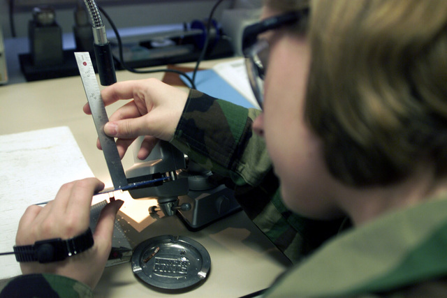 SENIOR AIRMAN (SRA) Jennifer C. Hanaway, USAF 31st Maintenance Squadron (MXS), Aviano AB, Italy work on circuit card assemblies while participating in the Micro Miniature/Miniature Electronic Repair Program, offered by Detachment 17 of the 372nd Training Squadron, at Spangdahlem AB, Germany