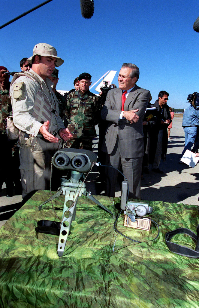 A U.S. Navy Seal (left) explains tactical observation equipment to The Honorable Donald H. Rumsfeld, U.S. Secretary of Defense (SECDEF), during a visit to Pope Air Force Base (AFB), N.C., Nov. 21, 2001.  The SECDEF is visiting Pope AFB and Fort Bragg to attend briefings and demonstrations on the capabilities of the U.S. Special Forces, consisting of U.S. Army Rangers and Special Forces Soldiers, U.S. Navy Seals and U.S. Air Force Combat Control Teams. (DoD photo by Helene C. Stikkel) (Released)