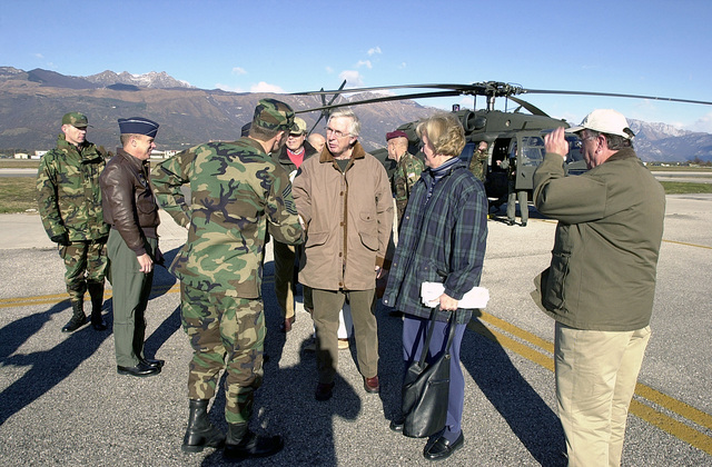 Command CHIEF MASTER Sergeant George Fust, USAF, welcomes Congressman Robert E. Cramer, (center), Alabama, arriving at Aviano Air Base in the UH-60 Black Hawk. Representative David L. Hobson, Ohio, and his wife, standing to the right watch the proceedings. The delegation arrived to discuss the ongoing NATO construction project Aviano 2000 at the base