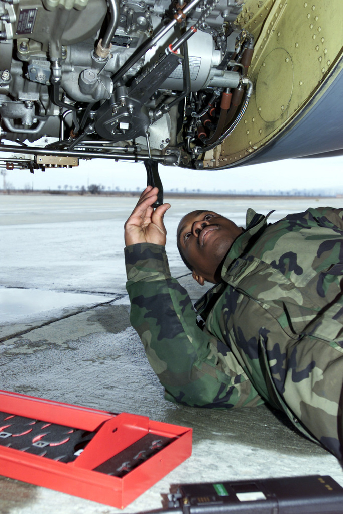 STAFF Sergeant (SSGT) Brandon Suber, 100th Aircraft Generation Squadron (AGS), replaces a main engine control unit on a KC-135R Stratotanker at Borgas International Airport, Bulgaria, in support of Operation ENDURING FREEDOM