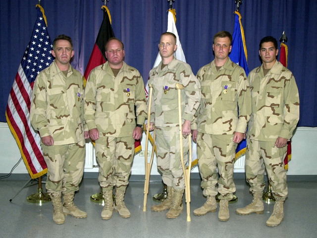 Five soldiers of the United States Special Forces, four United States Army and one United States Air Force (right), injured during the prison uprising in Quala-Jangi, Afghanistan, pose for a picture after receiving their Purple Heart medals at Landstuhl Army Regional Medical Center, Germany